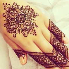 Mehndi Love the design on top of the hand! Not so much on the fingers.