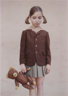 "Not a teddy bear per se, but a wonderful photo of a girl with a teddy bear by Loretta Lux, entitled (amazingly enough), ""Girl with a Teddy Bear.""  For sale at the upcoming Phillips photo auction in London, Nov. 17, 2013. ( Just FYI, Ms. Lux's photos sell between $5,000 and more than $20,000!)"