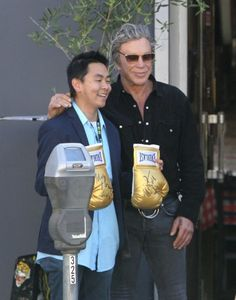 Mickey Rourke Photos Photos - Mickey Rourke autographs a pair of boxing gloves for a fan while out in Beverly Hills, California on April 1, 2017. - Mickey Rourke Autographs Boxing Gloves for a Fan in Beverly Hills