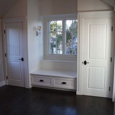 His and hers closets flanking window with a window seat in between for added storage.