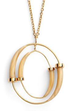 Free shipping and returns on Tory Burch Pendant Necklace at Nordstrom.com. An orbiting statement-sized pendant traced in horn-inspired accents brings this gilded necklace to a luxurious, flattering point.