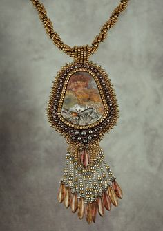 Crazy Lace Agate bead-bezelled and fringed cabochon, by Sue Horine