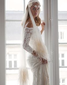 Feather adorned veil - have you ever seen anything so gorgeous?