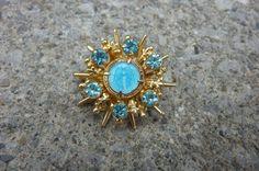 Vintage Blessed Mother Miraculous Medal Brooch Blue Rhinestones Set in Gold Tone Metal Blue Enamel Center Medal 1960's by ZoomVintage on Etsy