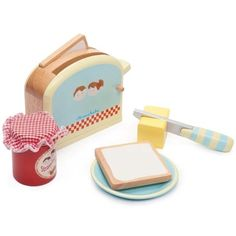 **SALE** A spring loaded pop-up toaster with 2 slices of toast, a butter pat with velcro, a pot of jam, a knife and a plate.