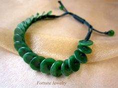 'Rolling in Fortune' Green 10mm Jade Coins Hand Knotted Bracelet- Feng Sui Energy Jewelry by Fortune Jewelry & Healing Beauty, http://www.amazon.com/dp/B00EXWOJVM/ref=cm_sw_r_pi_dp_Z-0jsb0E4P57P