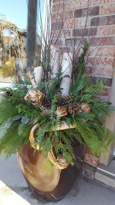 Christmas  urn with birch  poles  pine cones  Designed  by Liliana Merante