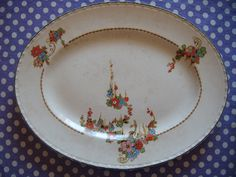 1930s serving dish with tiny color and gilt flowers