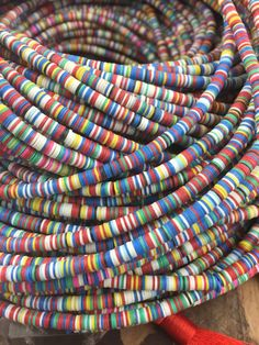 Winter Chill 4mm African Vinyl Record Disc Beads,  Multi-Colored, Bold Colors, Tribal Fashion, Bracelet, Necklace, Jewelry Making Supply by WomanShopsWorld Fabric Bracelets, Beaded Bracelets, Recycled Jewelry, Handmade Jewelry, African Jewelry, Tribal Fashion, Paper Beads, Bead Crafts, Paper Crafts