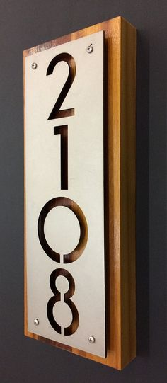 stainless steel cedar house numbers address plaque by Rancidmetals Entretien de Maison Custom Stainless Steel And Cedar House Number Address Plaque Door Design, Exterior Design, Design Design, Plate Design, Design Ideas, Door Numbers, Address Numbers, Cedar Homes, Address Plaque
