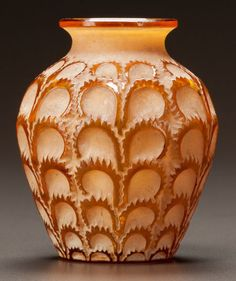 R. LALIQUE AMBER GLASS LAITERONS VASE WITH WHITE PATINA Circa 1931. Stenciled R. LALIQUE, FRANCE