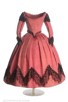 Dress, ca. 1854-1866, Spanish. Salmon colored silk moiré gros de Naples with black glass beads. Skirt has grenadine point lace, roses, and Richelieu embroidery. Made for Infanta Isabel of Bourbon
