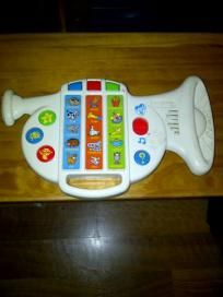 musical toy shaped like a hirn