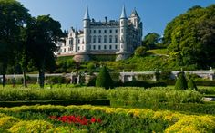 """Dunrobin Castle, Golspie, Sutherland, Scotland. It has its origins in the Middle Ages, but most of the present building is the work of Sir Charles Barry, the architect of the Palace of Westminster in London. The resulting house has a """"French Renaissance meets Scots Baronial"""" style. The French influence extends into the gardens, completed in 1850, inspired by the French formal style of the Gardens of Versailles."""