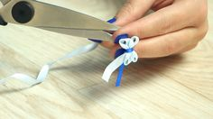 Wind ribbon through fork prongs and pull tight. The result? So cute!