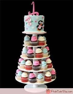 1st Birthday Winter Cupcake Tower I'm thinking with pink and blue snowflake cupcakes for boys and girls :)
