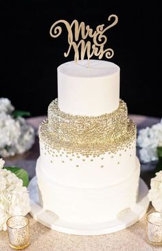 Elegant gold decorated white wedding cake; Featured Cake: Sweet Fix RVA