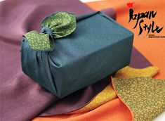 """This is a Japanese traditional wrapping cloth called a """"furoshiki. Traditionally used to hold your clothes when going to the baths, now used for gifting and carrying all manner of things."""