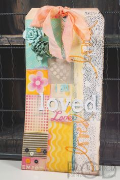 Mixed Media tag using Faber-Castell Design Memory Craft products. Our favorite part is the background- looks like patterned paper, but is actually just stamped paper using the Stamper's Big Brush Pens. By Lisa Adametz.