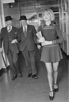 7th June 1974:  Two suited businessmen enjoy the sight of an attractive young secretary in a mini skirt.  (Photo by M. McKeown/Express/Getty Images)