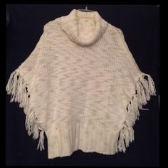 "CHICO'S IVORY KNIT PONCHO W/ FRINGE Knit is 85% Acrylic, 15% Wool.  Poncho is secure at the bottom by a 6"" Rib-Knit band.  NWOT.  Never worn, Excellent Condition.   Trades   PayPal Chico's Sweaters Shrugs & Ponchos"