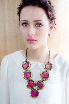 love the neutral shirt and a chunky, bright necklace