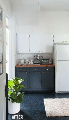 dark floors can work with dark cabinets... Via Manhattan Nest | Kitchen