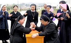 im not sure why, but i absolutely love this, maybe, i guess, because its asian nuns arm wrestling
