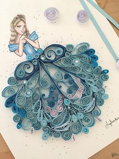 If you love the fairy tale princesses and want to recreate the dream world then here is this wonderful idea for you. you can draw the upper body of the princess and then adorn its dress with paper quilling. you can adopt a single color or its different tones. You can add sparkling glitter to make it more dreamy and cute.