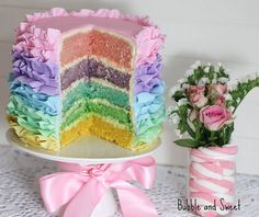 Rainbow pastel ruffle cake...she just used food coloring, not flavoring and used fondant icing to make the ruffles.  I would NOT use fondant which is a pain but settle for buttercream ruffles that don't stand out so much.  Still sweet rainbow look.