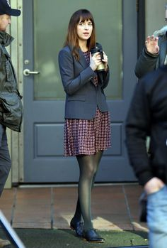 Dakota Johnson in pantyhose - http://stockings-celebs.blogspot.com/2014/12/dakota-johnson-danity-kane-debra-messing.html