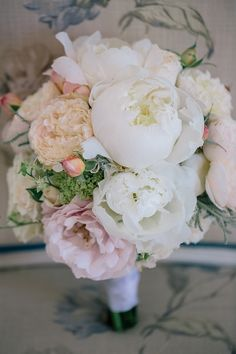 Pastel hued bouquet...what if you did this for bridesmaids but with a more orangey tint? @Chelsea Killinger