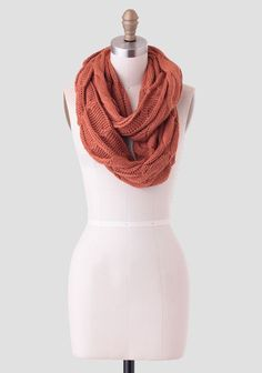 """Rendered in a soft knit, this rust-hued infinity scarf features a thick cable knit design. Perfect for adding warmth and texture to all your fall outfits. ,  ,  Imported,  13.5"""" W x 31."""