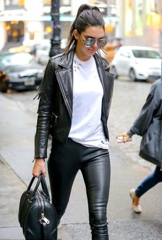 Kendall Jenner looked amazing in a leather moto jacket, white tee, and leather pants.