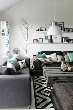 Living room....teal sofa, rustic wood, grey, black and white accents