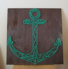 Get a piece of wood of your choice/style- hammer some nails in in the shape of a anchor- after you have a outline of an anchor get your choice of string(s) and start wrapping them around the nails- go crazy with it! Wrap it around every nail until you feel it is perfect.