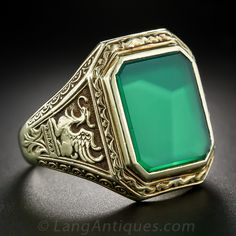 Gent's 14k and Chrysoprase Griffin Ring - A pair of vigilant griffins perched atop neo-classical columns guard a large and glowing green emerald-cut crysoprase in this handsome, rare, large scale and highly-distinctive vintage gent's ring, elegantly crafted in rich 14 karat gold. - Lang Antiques