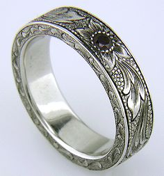 Hand engraved platinum band set with pyrope garnets.   I would prefer gold.  This is so beautiful!