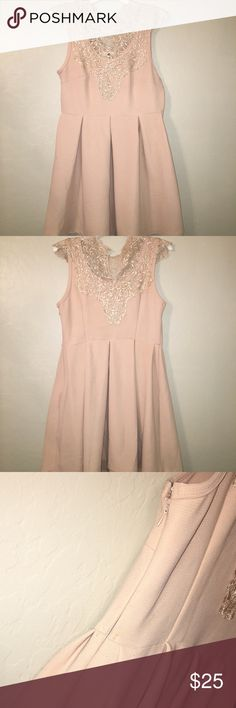 elegant homecoming/formal dress gently used. front and back shown. worn 2 times for a school dance and the other time on Christmas. light pink/blush color with a golden tan upper body embellishing. no stains. Dresses Midi