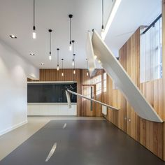 Arts Council England offices by Moxon Architects : Reclaimed timber is used to clad a small meeting room and to create durable panelling throughout the offices that unifies the different spaces. The tables can be hoisted out of the way to lie flat against the walls when not in use.