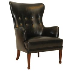 Frits Henningsen Armchair | From a unique collection of antique and modern wingback chairs at https://www.1stdibs.com/furniture/seating/wingback-chairs/