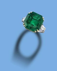 An important 14.93 carats cornered step-cut, Colombian emerald and diamond ring