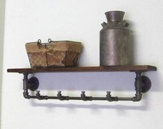 Great for small spaces, crafted of pine wood and rugged black steel pipes. The black steel pipes sealed with a clear coat lacquer while the pine wood shelf is distressed by hand to give it a time worn appearance. It has visible marks and indentations. Sealed with a clear lacquer to protect the wood without concealing its character.  Items are handmade upon ordering, so the piece you purchase may have slight variations from the photographed item. Please allow 1 to 2 weeks for your piece to be…