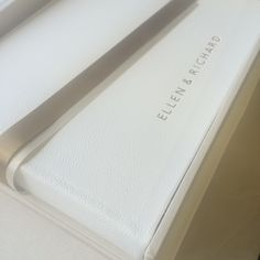White leather wedding album with matching clamshell box. Personalised silver lettering on album and box. Hand bound by www.blackcatbindery.com