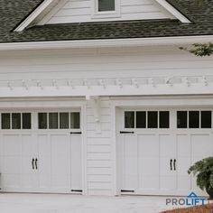 Add a little bit of style to your garage doors and WOW what a difference it makes! Shown here: carriage house garage doors with extra tall windows, decorative handles and hinges in bright white. Notice the pergola overhead for the finishing touch! | ProLift Garage Doors on Houzz | Project and Photo Credits: ProLift Garage Doors Savannah
