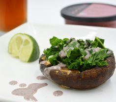 Kale Stuffed Portobellos are SO easy! Just brush your mushrooms with oil and roast them for up to 10 minutes in a 375 degree oven, until they look juicy. Reserve a tablespoon of the juice and combine with 1 1/2 tsp Roots Black Bean Hummus and the juice from half a lime. Combine until drizzlable. Meanwhile, steam chopped kale in a small amount of water until it's tender and a nice shade of green (don't overcook). Stuff the peppers with kale and drizzle with the Black Bean sauce. #yum #vegan
