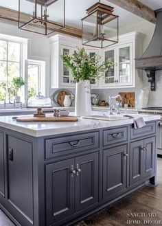 Country Kitchen with Dark Center Island-double lantern pendants-honed marble countertops-white glass cabinets-french range hood Country Kitchen Designs, French Country Kitchens, Rustic Kitchen Design, Modern Farmhouse Kitchens, Home Decor Kitchen, Kitchen Interior, Home Kitchens, Kitchen Ideas, Modern French Kitchen