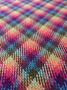 http://www.ravelry.com/projects/cuddlycritter/planned-pooling-blanket-2