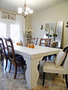 You don't have to go over the top to bring a fall-inspired look to your interior space. Alicia decorated her rustic dining table by placing pumpkins and gourds in a row. A tall vase filled with wheat sits in the center, adding height to the space.