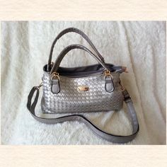 Beautiful Color Silver Grey Handbag w/ Dustbag Used only one time. Basically it is like NEW. UNIQUE Design small in sizeI'm firm in price. Jovanni Bags Satchels